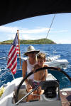 Lou getting some help at the helm while sailing on St John